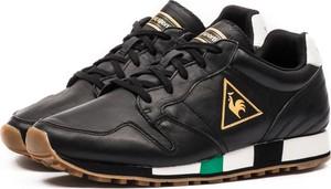 Brązowe buty sportowe Le Coq Sportif w sportowym stylu