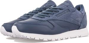 Niebieskie buty sportowe Reebok sznurowane w street stylu ze skóry