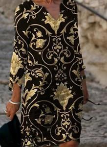 Czarna sukienka Arilook z dekoltem w kształcie litery v w stylu boho z długim rękawem