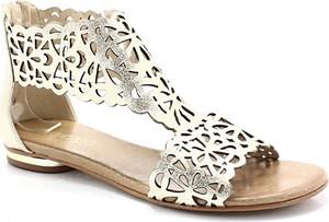 Złote sandały Tymoteo ze skóry z płaską podeszwą na zamek
