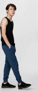 Niebieskie spodnie sportowe 4F w sportowym stylu