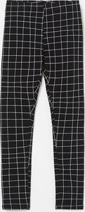 Czarne legginsy dziecięce Reserved w krateczkę