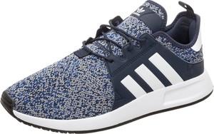 Niebieskie buty sportowe Adidas Originals sznurowane w sportowym stylu