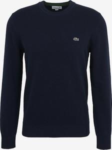 Niebieski sweter Lacoste z bawełny z okrągłym dekoltem