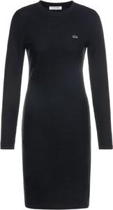 Czarna sukienka Lacoste z długim rękawem dopasowana midi