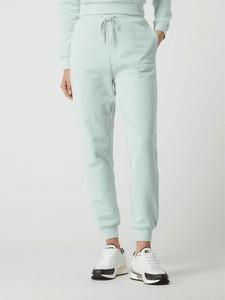 Miętowe spodnie Guess z dresówki