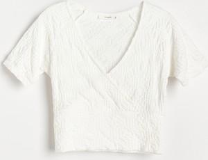 Bluzka Reserved z dekoltem w kształcie litery v z dzianiny z krótkim rękawem
