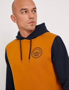 Pomarańczowa bluza Diverse w młodzieżowym stylu z dzianiny
