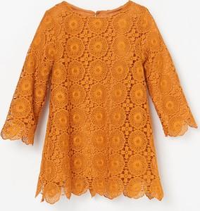 Pomarańczowa sukienka dziewczęca Reserved