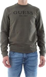 Zielony sweter Guess w młodzieżowym stylu