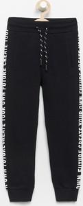 Czarne spodnie dziecięce Reserved z bawełny