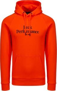 Pomarańczowa bluza Peak performance w młodzieżowym stylu