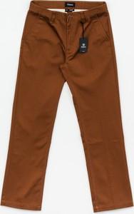 Pomarańczowe spodnie Brixton z żakardu