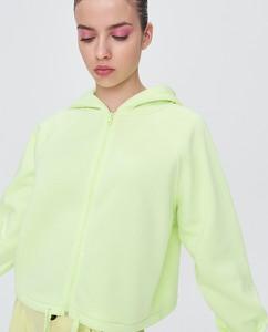 Zielona bluza Sinsay krótka w młodzieżowym stylu