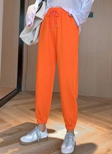 Pomarańczowe spodnie Arilook