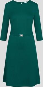 Zielona sukienka ORSAY z długim rękawem z dzianiny trapezowa