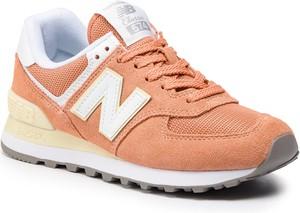Pomarańczowe buty sportowe New Balance na koturnie