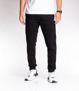 Czarne spodnie SSG z bawełny w sportowym stylu