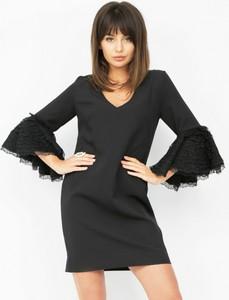 Czarna sukienka Piu z długim rękawem z dekoltem w kształcie litery v