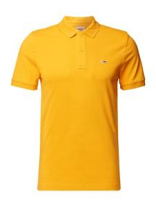 Żółta koszulka polo Tommy Jeans w stylu casual
