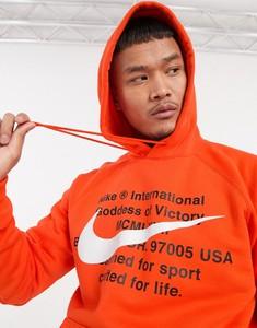 Pomarańczowa bluza Nike z nadrukiem
