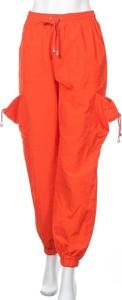 Pomarańczowe spodnie sportowe Missguided w sportowym stylu