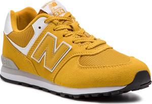 Żółte buty sportowe New Balance na koturnie w sportowym stylu ze skóry