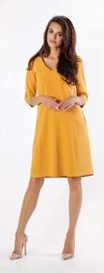 Żółta sukienka Nommo z długim rękawem rozkloszowana midi