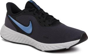 Granatowe buty sportowe Nike sznurowane revolution