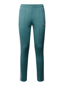 Zielone spodnie Adidas Originals w sportowym stylu