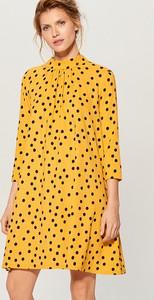 Żółta sukienka Mohito trapezowa midi
