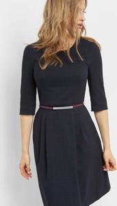 Granatowa sukienka ORSAY z długim rękawem rozkloszowana w stylu casual