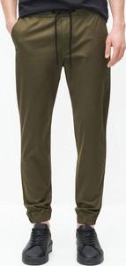 Zielone spodnie Reserved w stylu casual z bawełny