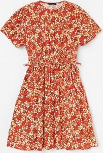 Pomarańczowa sukienka dziewczęca Reserved w kwiatki