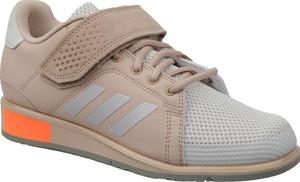 Buty sportowe Adidas z płaską podeszwą w młodzieżowym stylu sznurowane