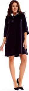 Czarna sukienka omnido.pl z dekoltem typu choker mini