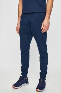 Granatowe spodnie sportowe Under Armour