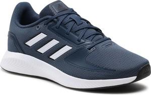 Granatowe buty sportowe Adidas sznurowane w sportowym stylu