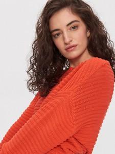 Czerwony sweter House