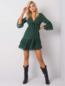 Zielona sukienka Sheandher.pl z dekoltem w kształcie litery v mini
