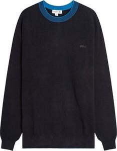 Niebieski sweter Lacoste z okrągłym dekoltem z wełny
