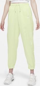 Zielone spodnie Nike w sportowym stylu z tkaniny