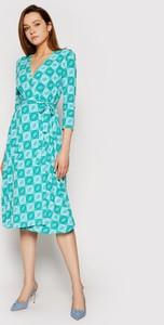 Niebieska sukienka Guess midi z długim rękawem