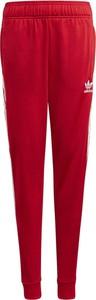 Czerwone spodnie dziecięce Adidas dla chłopców