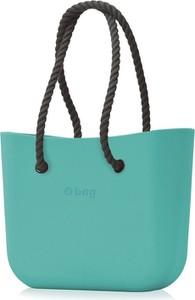 Turkusowa torebka O Bag na ramię w wakacyjnym stylu