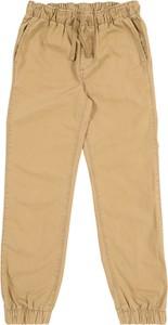 Brązowe spodnie dziecięce Gap z bawełny