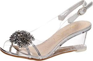 Sandały Suzana z klamrami ze skóry na koturnie