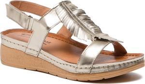 Złote sandały Pollonus na niskim obcasie ze skóry w stylu casual